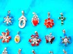 Rhinestone charms imported at wholesale price. Gorgeous silver pendants in fun designs inlaid with colored cz crystals