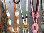 Gift shop wholesale agent supplies beaded necklace fashions. Colored beaded necklace with shells interspersed through