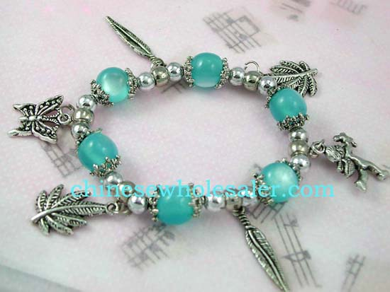China products Semi-precious gem charms wholesale distributed. Blue beaded strecthy charm bracelet with butterfly, cupid, butterfly, and leaf pattern