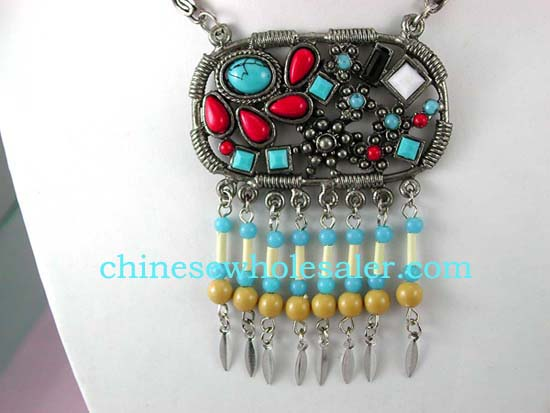 Beaded jewelry wholesale catalog supplies necklaces online. Fashion metal chain necklace with oval circle pendant embeded with multi tiny beads in assorted colors and more beads hanging on bottom.