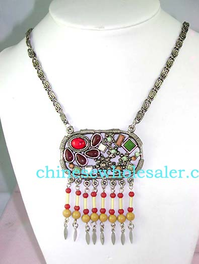 Wholesale replica jewelry distributor supplies necklace fashions online. Fashion metal chain necklace with oval circle pendant embeded with multi tiny beads in assorted colors and more beads hanging on bottom.