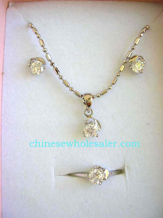 Jewelry supply company impoting wholesale cz jewelry gift set. Fashion jewelry box set, silver plated necklace, stud earring and ring with round clear cz holding a leaf design. Spring ring clasp .