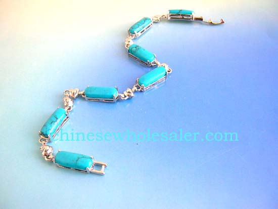 Turquoise jewelry bracelets are wholesale distributed to retail outlets. Turquoise fashion bracelet in long shape connected with silver heart design and chain lock for closure