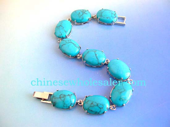 Wholesale precious gemstone jewelry distributor sells Turquoise fashion bracelet in oval shape with chain lock for closure    .