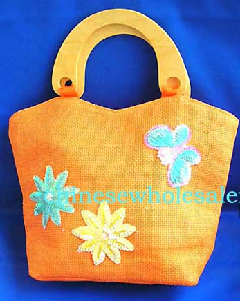 Manufactured purse womens accessory handbag wholesale supplying Orange canvas fabric with sequins hand bag motif green and yellow flowers with butterfly on right hand side in sparkle chips and thread work, also wooden handle design