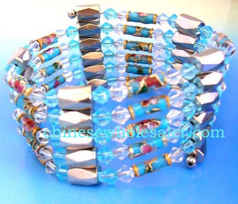 Single string therapy hematite wrap imported from China manufacturing company. Combines long enamel cloisonne flower beads, blue and light pink rhinestone and faceted cylinder shape magnetic hematite beads inlaid. Works well as a necklace, bracelet, choker or anklet.