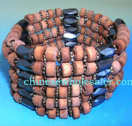 Beaded bracelet jewelry distributes China imported products.  Pink wooden beads, flower shaped ilver beads and multi faceted cylinder hematite beads. Wear as necklace, bracelet, or arm band.
