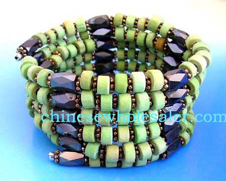 Magnetic health products supplied wholesale by China importer. Green wooden beads, flower shaped silver beads and multi faceted cylinder hematite beads. Wear as necklace, bracelet, or arm band.
