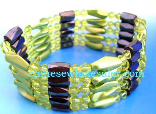Wholesale hematite wrap wholesale company exporting China made jewelry. Translucent green rhinestones, green long facted cylinder beads and faceted cylinder shape magnetic hematite beads inlaid. Wear as a necklace, bracelet, choker