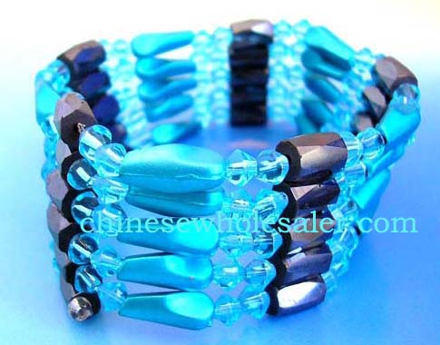 China wholesale therapy jewelry imported for retail purchase. light Blue rhinestones, long blue cylinder beads and faceted cylinder shape magnetic hematite beads inlaid. Can be a necklace, bracelet,or arm band