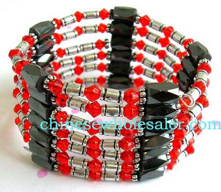 China direct manufacturer distributing beautiful hematite jewelry for therapeutic purposes. Wraps with red rhinestones, silver oblong and flower beads, and faceted cylinder shape magnetic hematite beads.