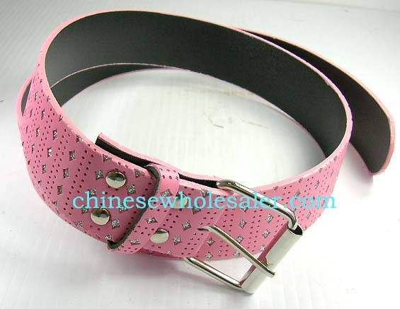 Womans clothing made in China imported by wholesale supplier. Pink imitation leather belt with diamond shaped stones imbedded, punched hole design throughout, and silver buckle.