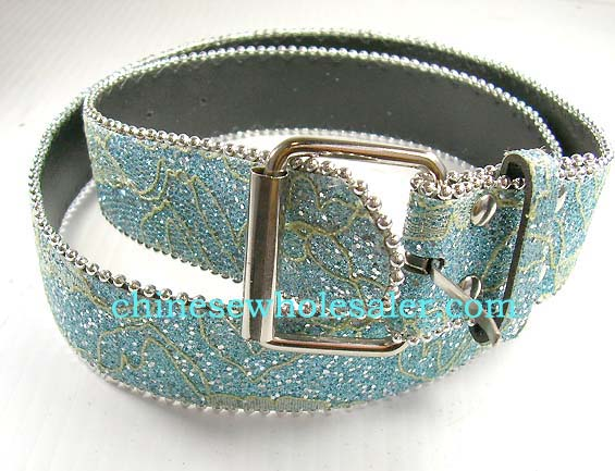 Wholesale beaded belts impoted from China factory. Fun baby blue belt with green graffiti art design and round silver beads outlining