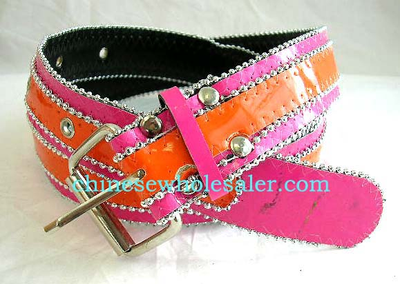 Teen girl accessories supplied online by China wholesale manufacturer. Fashion pink and orange imitation leather belt with silver colored beads outlining orange and pink colors