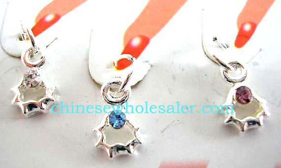 Nail art supplies imported from China wholesale factory. Sunburst shape fingernail dangling ring piercing.