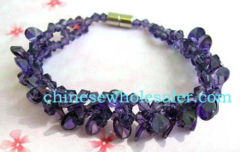 Jewelry online distributiob business importing made in China products. Amethyst-purple bracelet created from multiple Chrystals with screw-up clasp for attachment.