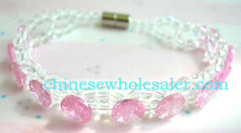 China manufactured bracelt jewelry distributed by online exporter. Bracelet created from two strings of clear beads with circular pink rhinestones inlaid throughout. Screw-up clasp as attachment