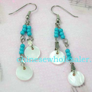 China online jewelry products exported for retail sales. Hanging fish hook earrings with silver plated chain holding turquoise colored beads that suspend mother of pearl colored circle cut-outs..