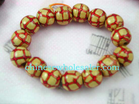 Wooden beaded supplied by China wholesale online distributers. Bracelet designed with red line checkered pattern on yellow bead.