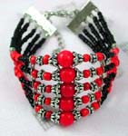 China import jewelry manufacturers distributing silver and bead jewelry.  Fashion bracelet with five small black beaded strings each holding decorated silver beads and a large red bead in center.