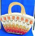 Wholesale fabric handbag manufactured and distributed from retail sale. Multi red straw hand bag with double wooden handle, zipper closure and inner pocket design