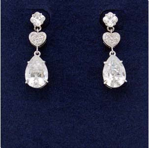 Vintage wholesale crystal jewelry inspirations supplied online by export agent. dangling imitation diamond earring with circular stud extending to heart shape and then large oval