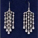 Unique and vintage jewelry importer distributing wholesale crystal earrings. Rows of rhodium plated chain and cz stones hanging from threader earing with large cz chrystals located at bottom.