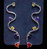 Cz jewelry sold online from distribution manufacturer. Curvy rhodium plated poles with yellow, purple, red, and blue cz stones attached to sides.