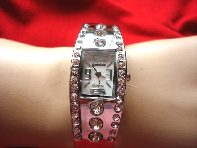 Online Silver bangle bracelet watch with center lined stones and small gems outsourcing exporter