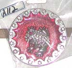 Round dinosaur belt buckle with red background and mini clear cz embedded around