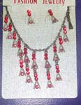 Rhinestone fashion accessory distribution company. Ruby red gemstone jewelry set with silver plated chain