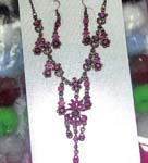 Womens China direct jewelry set wholesale store. Pink crystals in floral motif necklace and earrings