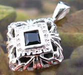 Stamped 925. sterling silver pendant in handcrafted diamond shape  with a black cz stone central decor