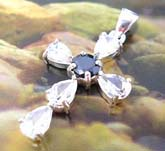 5 clear water-drop shape cz stone embedded sterling silver cross pendant holding a rounded black cz at center