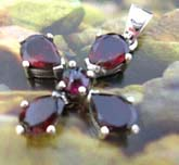 925. sterling silver cross pendant with 5 red garnet stone inlaid