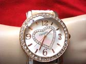 Heart theme clock face on jeweled frame of fashion watch