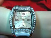Dali inspired quartz clock face on silver fashion watch with cz gems along frame
